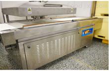 KDK1000输送带式真空包装机